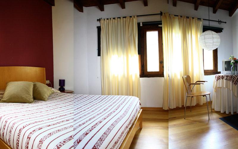 posada-tollo-habitaciones-suite-cama-2